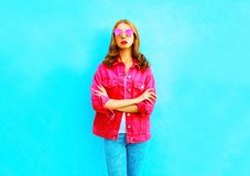Fashion young woman in pink denim jacket Royalty Free Stock Image
