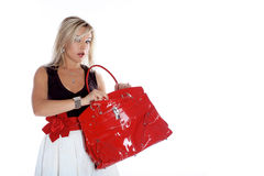 Fashion young woman with red bag Stock Photos