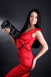 Fashion young woman in red dress Royalty Free Stock Photography
