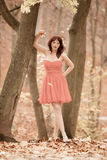 Fashion young woman in red dress relaxing in park Royalty Free Stock Photos