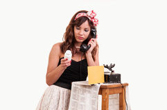 Fashion young woman with a retro look speaks at a vintage phone Royalty Free Stock Photo