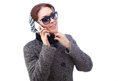 Fashion young woman speaks by phone. All isolated Royalty Free Stock Photo