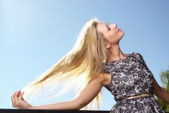 Fashion young woman in summer dress in park Stock Images