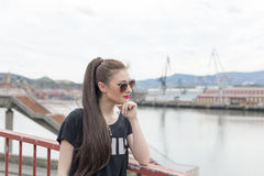 Fashion young woman with sunglasses looking away. Royalty Free Stock Photo