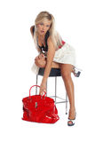 Fashion young woman taking red bag Stock Photography