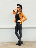 Fashion young woman wearing a black hat sunglasses in profile over grey Royalty Free Stock Image