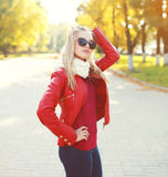 Fashion young woman wearing a red leather jacket with scarf Stock Photo