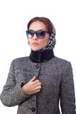 Fashion young woman is wearing sunglasses and coat Royalty Free Stock Photography