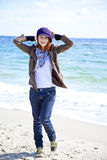 Fashion young women at the beach in sunny day. Royalty Free Stock Photography