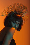 Fashionable african american girl in headpiece with needles looking at camera Stock Photos