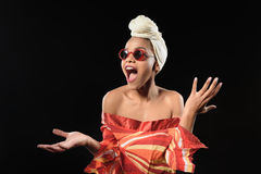 Fashionable african woman shouting with shock. Crazy about fashion. Young mulatto girl is standing and screaming. She is wearing traditional african clothing Stock Photo