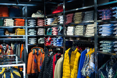 Fashionable apparel store with shirts Stock Photo