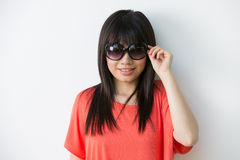 Fashionable Asian woman wearing sunglasses. Royalty Free Stock Image