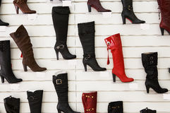Fashionable autumn a boot. Sale fashionable autumn a boot in shoe shop Royalty Free Stock Photos