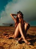 Fashionable aviator woman sitting smokey plane Royalty Free Stock Photography