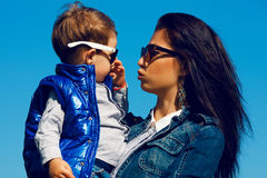 Fashionable baby boy and his gorgeous mother Royalty Free Stock Image