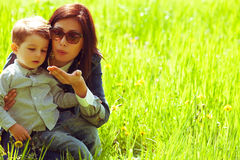 Fashionable baby boy and his gorgeous mother Stock Photos