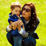 Fashionable baby boy and his gorgeous mother Stock Photo