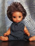 Fashionable baby doll in black clothes to the point royalty free stock image