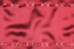 Fashionable beautiful background, red satin ribbon inserted in   fabric Stock Photo