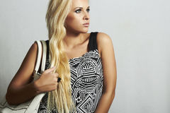 Fashionable beautiful blond woman with with handbag. shopping Stock Photos