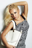 Fashionable beautiful blond woman with with handbag. shopping Stock Photo