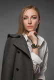 Fashionable Beautiful Blond Woman. In topcoat.trendy Beauty blonde Girl Royalty Free Stock Image