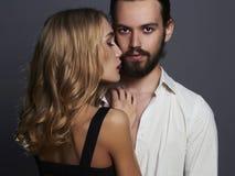 Fashionable beautiful couple. woman near the man Stock Photography