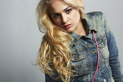 Fashionable beautiful girl in jeans. denim jeans wear Royalty Free Stock Photo