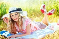 Fashionable and beautiful girl sunbathing on the sun Stock Photo