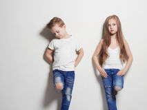Fashionable beautiful little couple. beauty girl and boy Royalty Free Stock Image