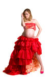Fashionable beautiful pregnant in luxurious skirt. With professional make-up isolated on white background Royalty Free Stock Photo