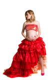 Fashionable beautiful pregnant in luxurious skirt. With professional make-up isolated on white background Stock Photos