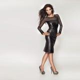 Fashionable beautiful woman posing. Royalty Free Stock Photography