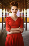 Fashionable beautiful woman in red dress Stock Image
