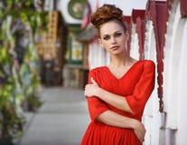 Fashionable beautiful woman in red dress Stock Photo