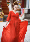 Fashionable beautiful woman in red dress Stock Photos