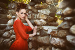 Fashionable beautiful woman in red dress Royalty Free Stock Photos