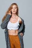 Fashionable beautiful woman in warm knitted cardigan Stock Photos