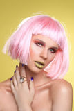 Fashionable Beautiful Woman Wearing a Styled Wig Closeup Stock Photo