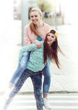 Fashionable beautiful young girlfriends standing Royalty Free Stock Photography