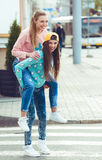 Fashionable beautiful young girlfriends standing Royalty Free Stock Photos