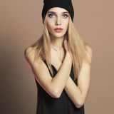 Fashionable beautiful young woman in cap. beauty blond girl Royalty Free Stock Photography
