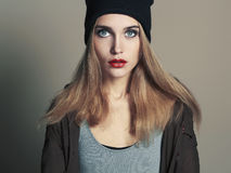 Fashionable beautiful young woman in cap. beauty blond girl in hat Royalty Free Stock Photo