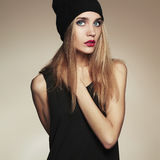 Fashionable beautiful young woman in cap. beauty blond girl in hat Stock Image