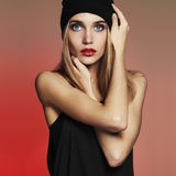 Fashionable beautiful young woman in cap. beauty blond girl in hat Stock Images
