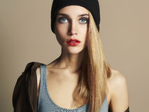 Fashionable beautiful young woman in hat. beauty blond girl in cap Royalty Free Stock Photo