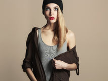 Fashionable beautiful young woman in hat. beauty blond girl in cap. Casual wear.autumn fashion collection Stock Photography