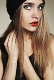 Fashionable beautiful young woman in hat. beauty blond girl in cap. Casual wear.autumn fashion collection Stock Photos