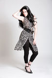 Fashionable beauty. Beautiful woman with long black hair and fashionable outfit Royalty Free Stock Image